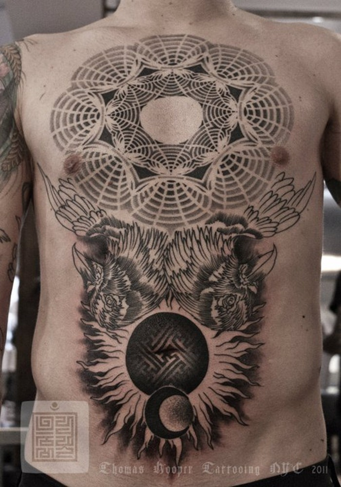 a-sacred-geometry-tattoo-by-artist-and-designer-thomas-hooper-wth-birds-sun-and-moon.jpg