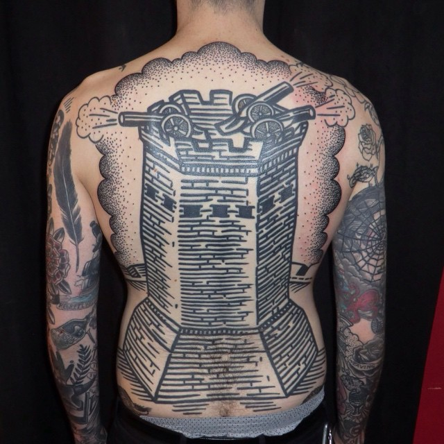 in2u-tattoo-tower-on-mans-back-640x640.jpg