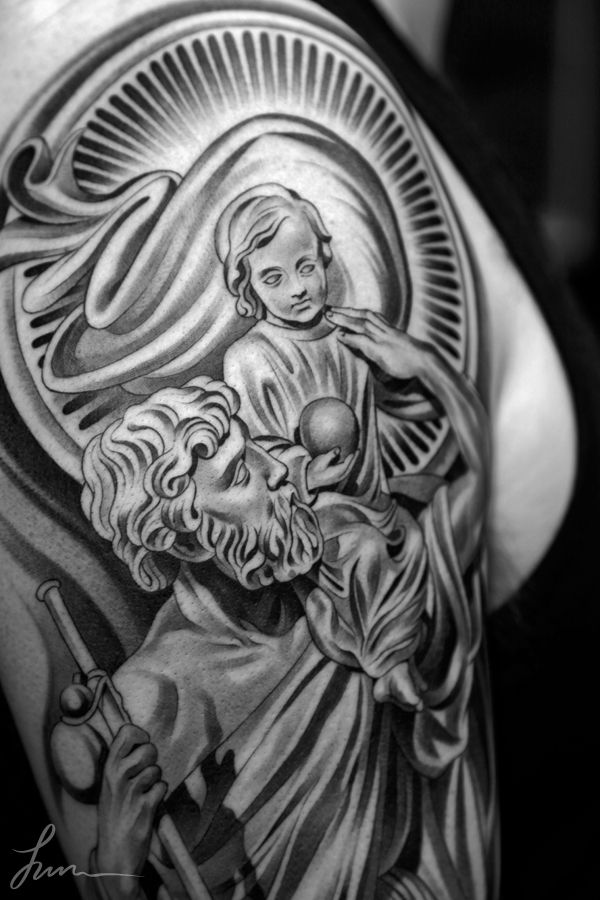 Black-And-Grey-Saint-Christopher-Tattoo-Design-For-Shoulder-By-Juncha.jpg