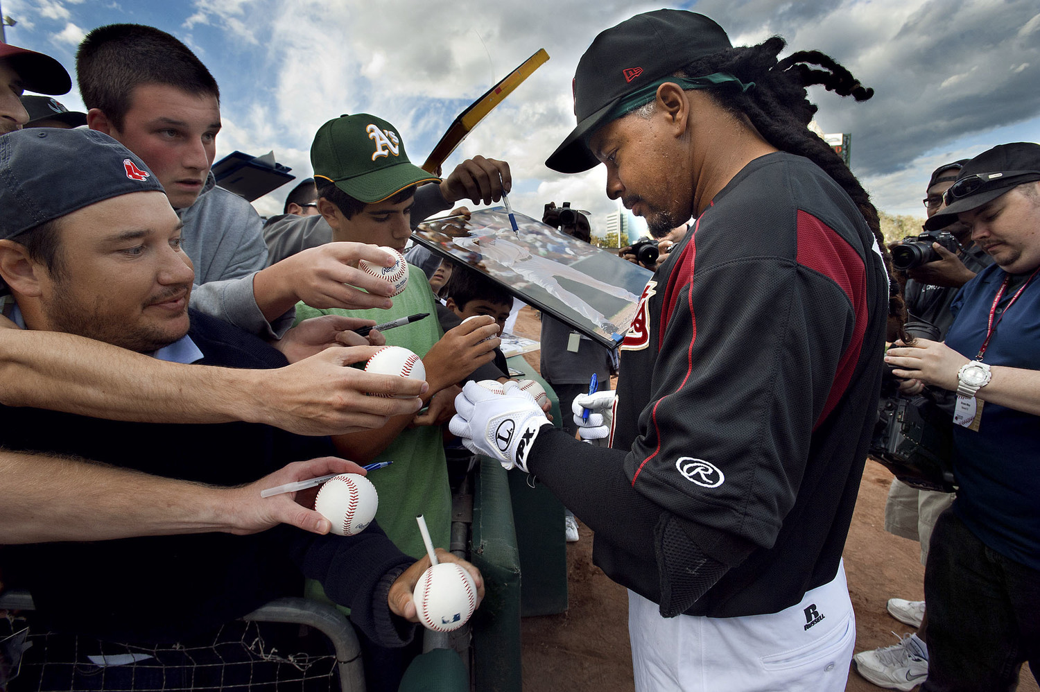 The River Cats' left fielder Manny Ramirez (11) signs autographs briefly  prior to the game between the Sacramento River Cats and the Reno Aces at Raley Field in West Sacramento on Friday, May 25, 2012.
