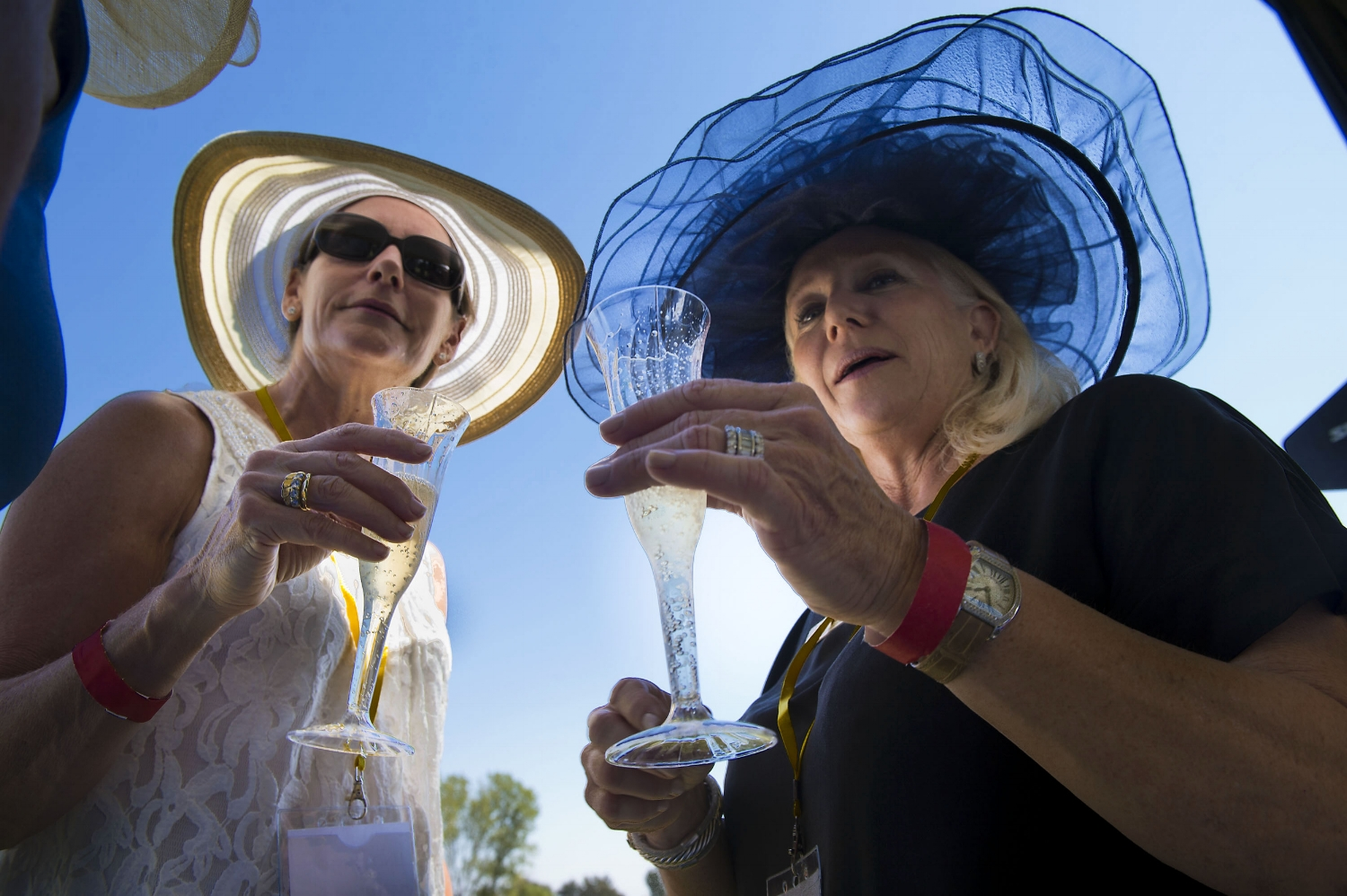 Linda Lasher, left, and Shari Lasher enjoy a glass of Champagne during a polo match at Chamberlain Ranch in Wilton on Saturday, September 14, 2013.