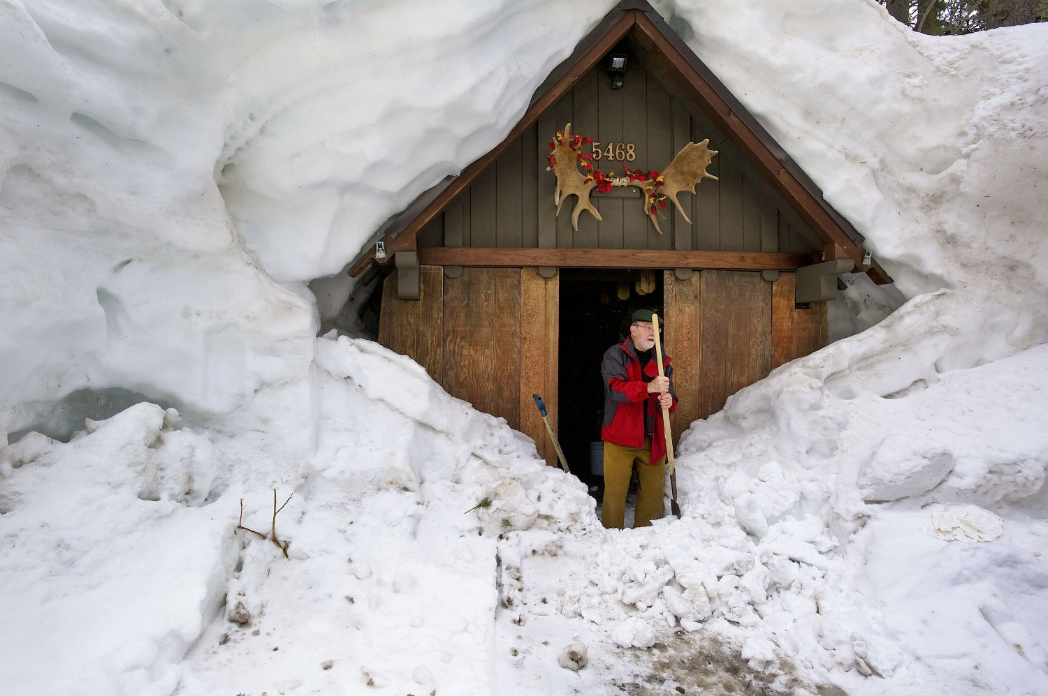 Cliff Raisbeck prepares to clear snow from in front of his front door at Serene Lakes near Truckee on Monday, April 11, 2011.