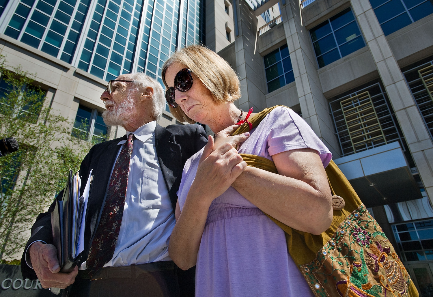 Anti-war activist Cindy Sheehan, right, with her attorney Dennis Cunningham outside the Federal Courthouse in Sacramento on Thursday, April 19, 2012.