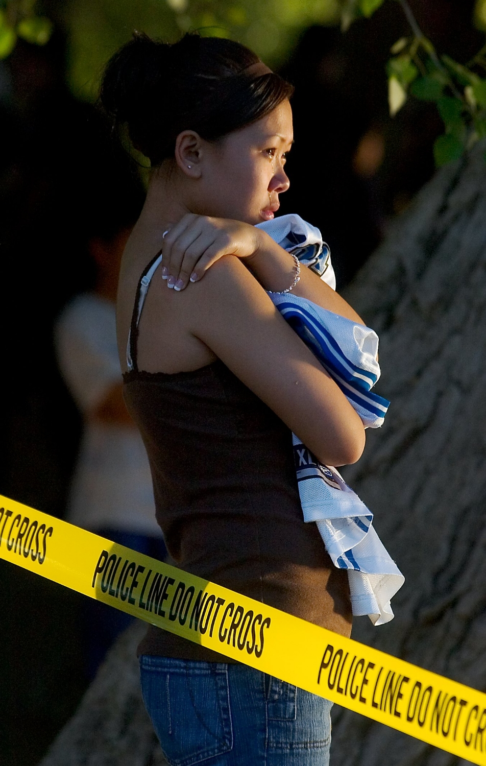 Julie Saeteurn 13, cries while she waits for law enforcement divers to recover the body of her boyfriend Jimmy Saeteurn from the river at Discovery Park in Sacramento on Thursday May 18, 2006.