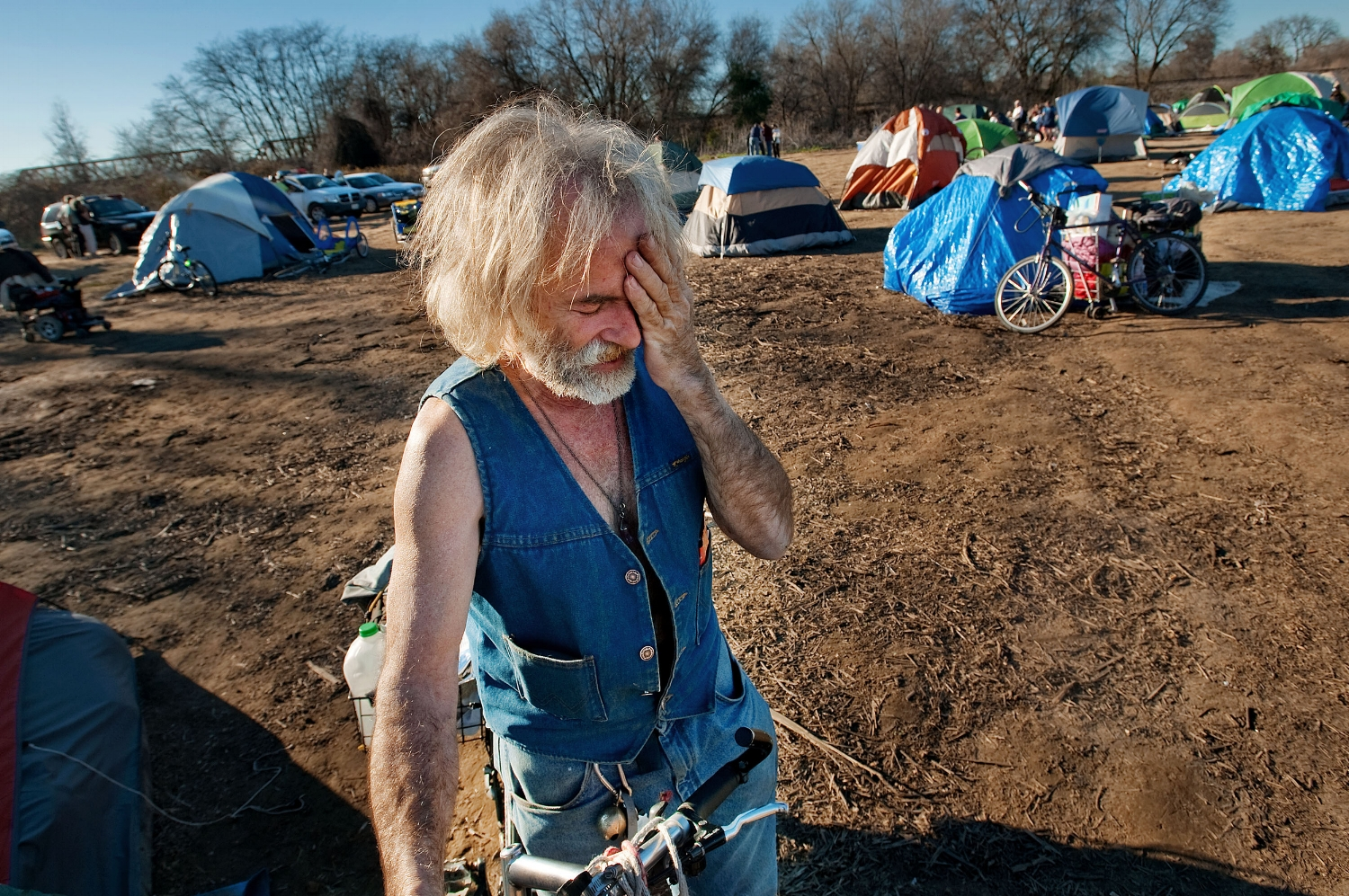 """Homeless camper Tim Buckley at the former """"SafeGround' encampment along the American River Parkway in Sacramento on Wednesday, February 9, 2011. Authorities gave out notices to homeless campers along the river. What had been called a """"Safeground' for homeless campers is now being vacated, and campers were given 48 hours to move out, or be cited."""