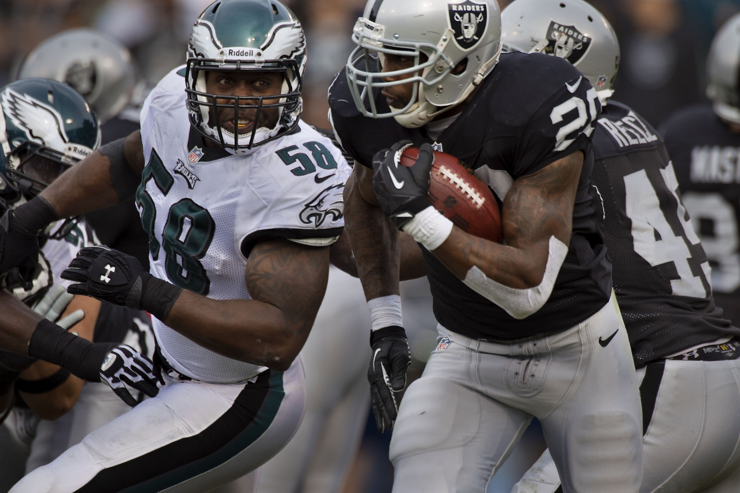 Raiders running back Darren McFadden (20) runs past Eagles outside linebacker Trent Cole (58) during the game between the Oakland Raiders and the Philadelphia Eagles at O.co Coliseum in Oakland on Sunday, November 3, 2013.