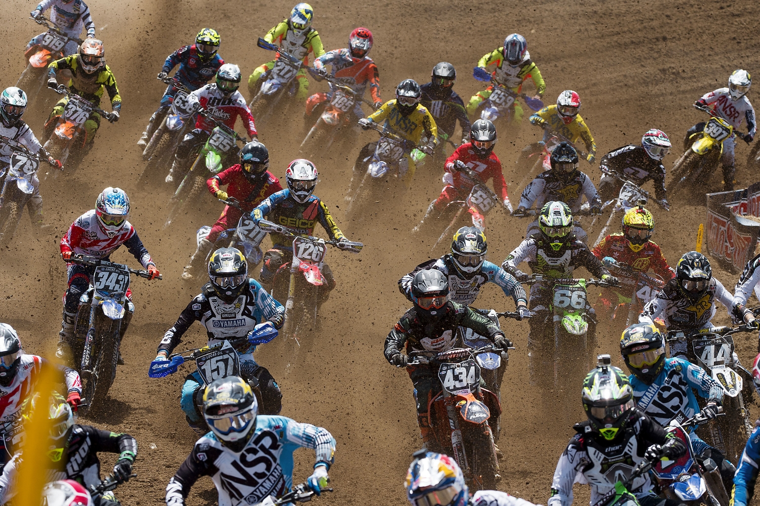 Riders race through the dirt in the first 250 moto during the annual Hangtown Motocross Classic motocross event at Prairie City SRVA in Rancho Cordova on Saturday, May 16, 2015.