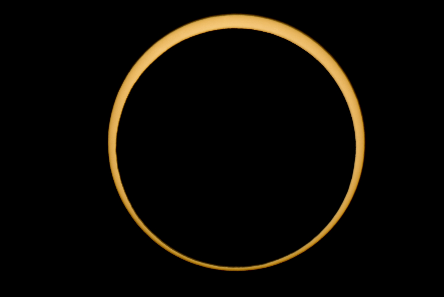 The moon is silhouetted against the sun in this annular solar eclipse near McCloud, CA on Sunday, May 20, 2012. Unlike a total solar eclipse, the sun is not completely obscured due to the moon's greater distance from the earth.