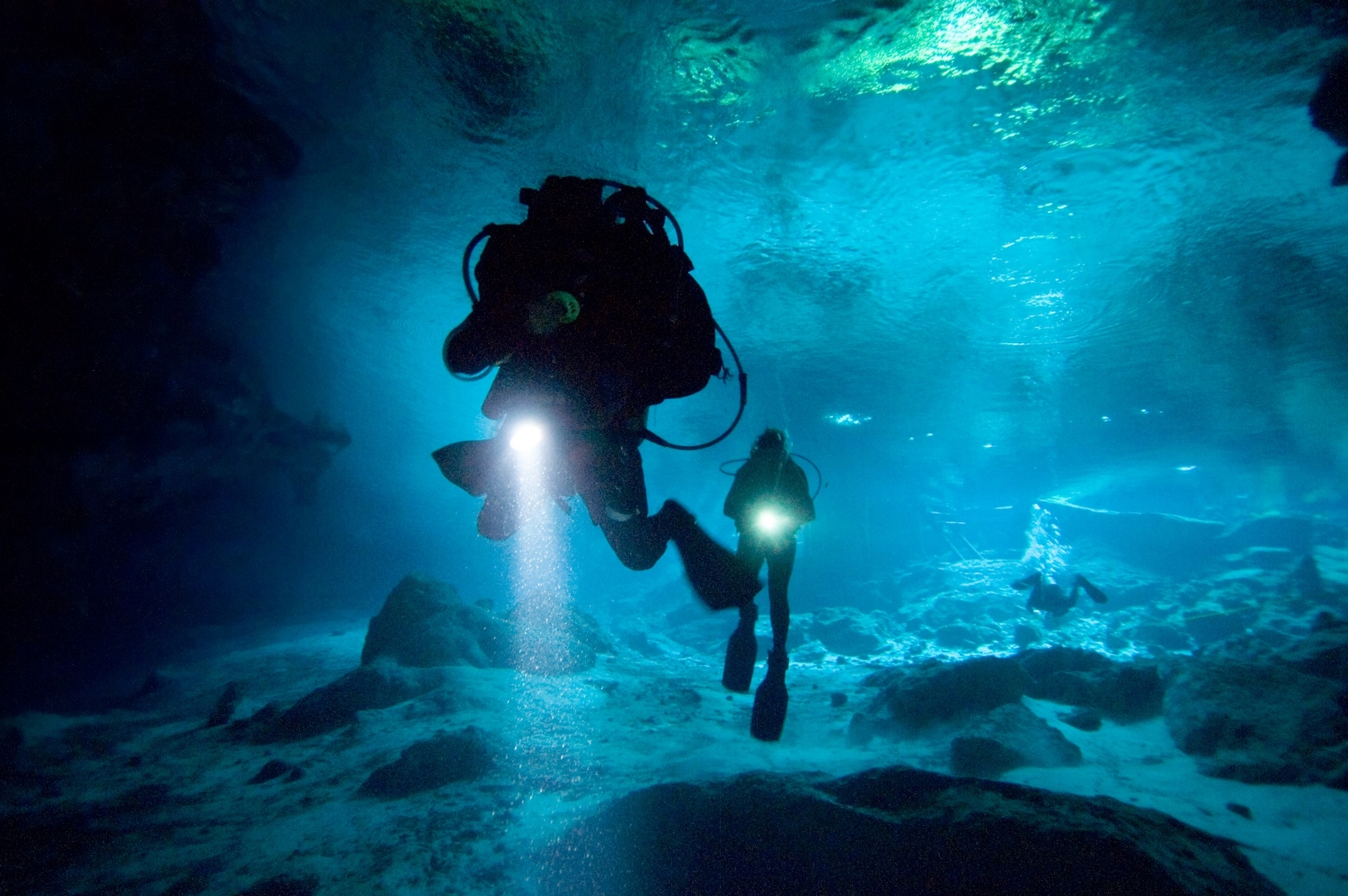 With flashlights in hand, cavern divers Mariana Leal, right, and Darlene Ott enter Dos Ojos cenote near Playa del Carmen Mexico on Thursday May 31, 2007.  Cenotes are entrances to a huge freshwater-filled cave system in theRiviera Maya area of Mexico.