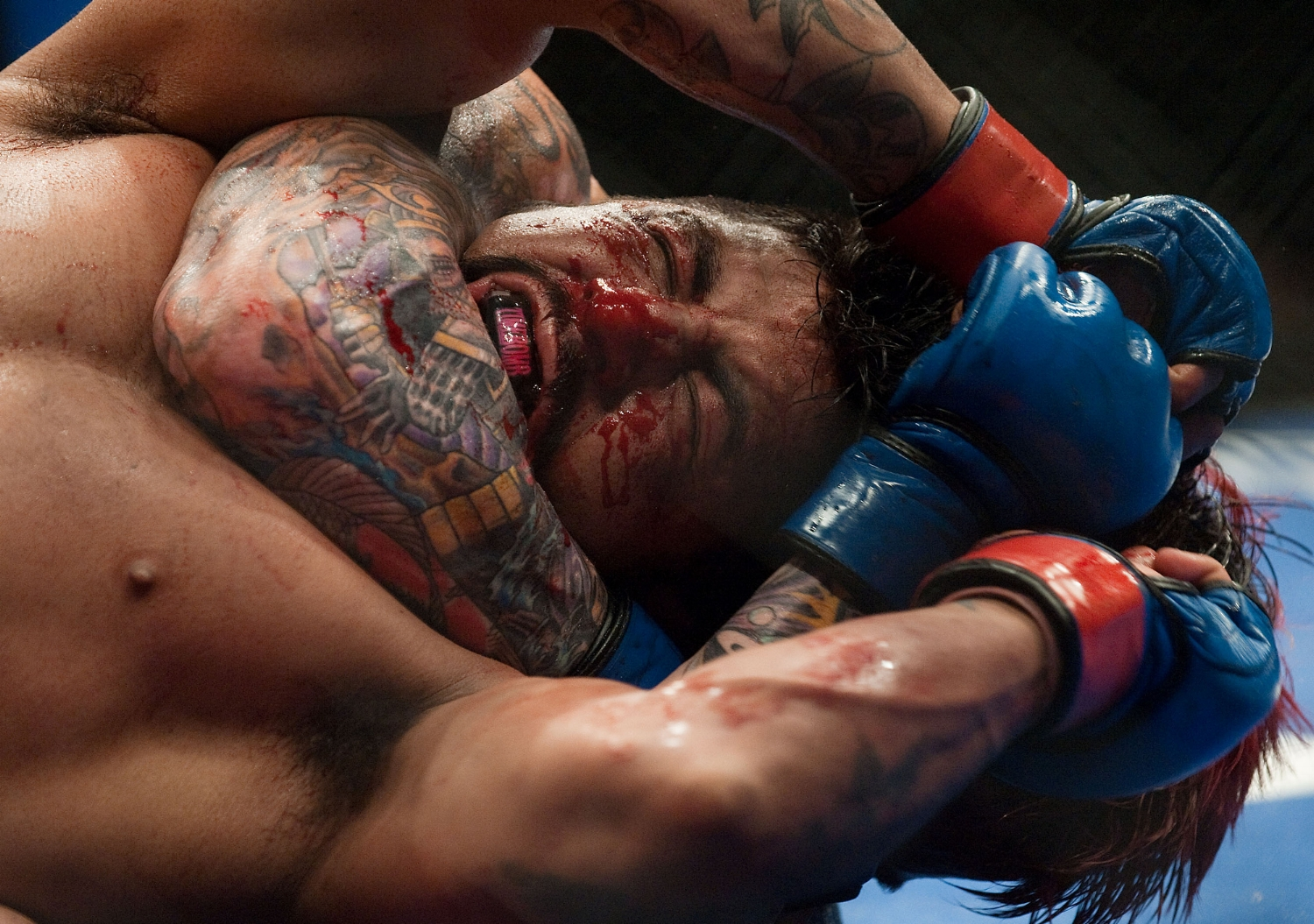 Antonio Banuelos is bloodied by opponent Scott Jorgensen during their bantamweight undercard fight at Arco Arena on Saturday. Banuelos lost the fight by decision.