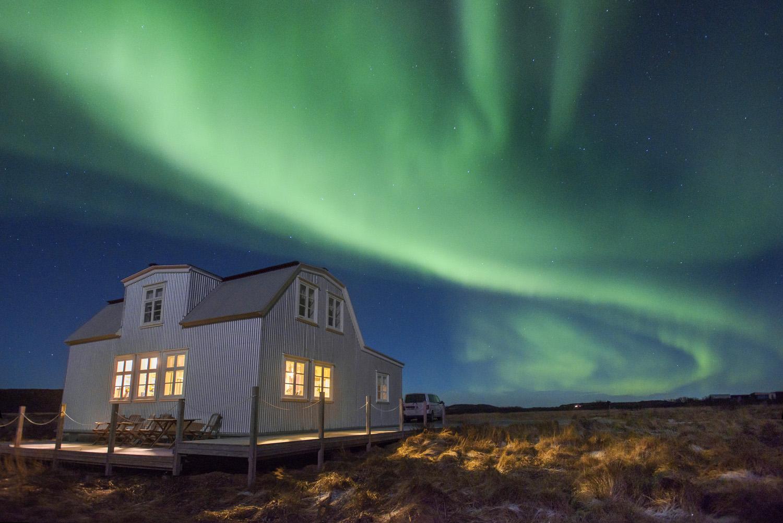 Aurora Borealis over the Lambalaekur farmhouse in Borgarnes, Iceland on Tuesday, December 26, 2017.
