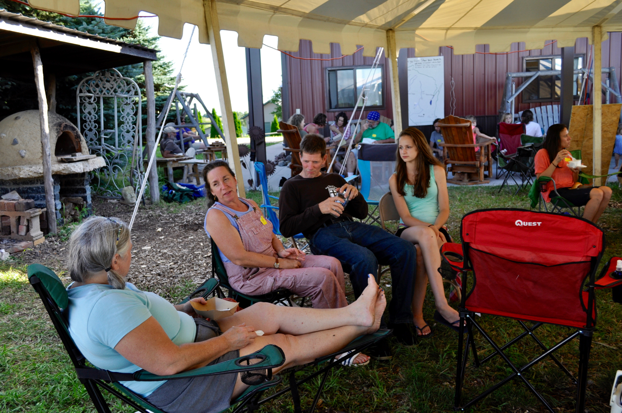 Attendees hangout during a meal at the 2016 Wisconsin Permaculture Convergence