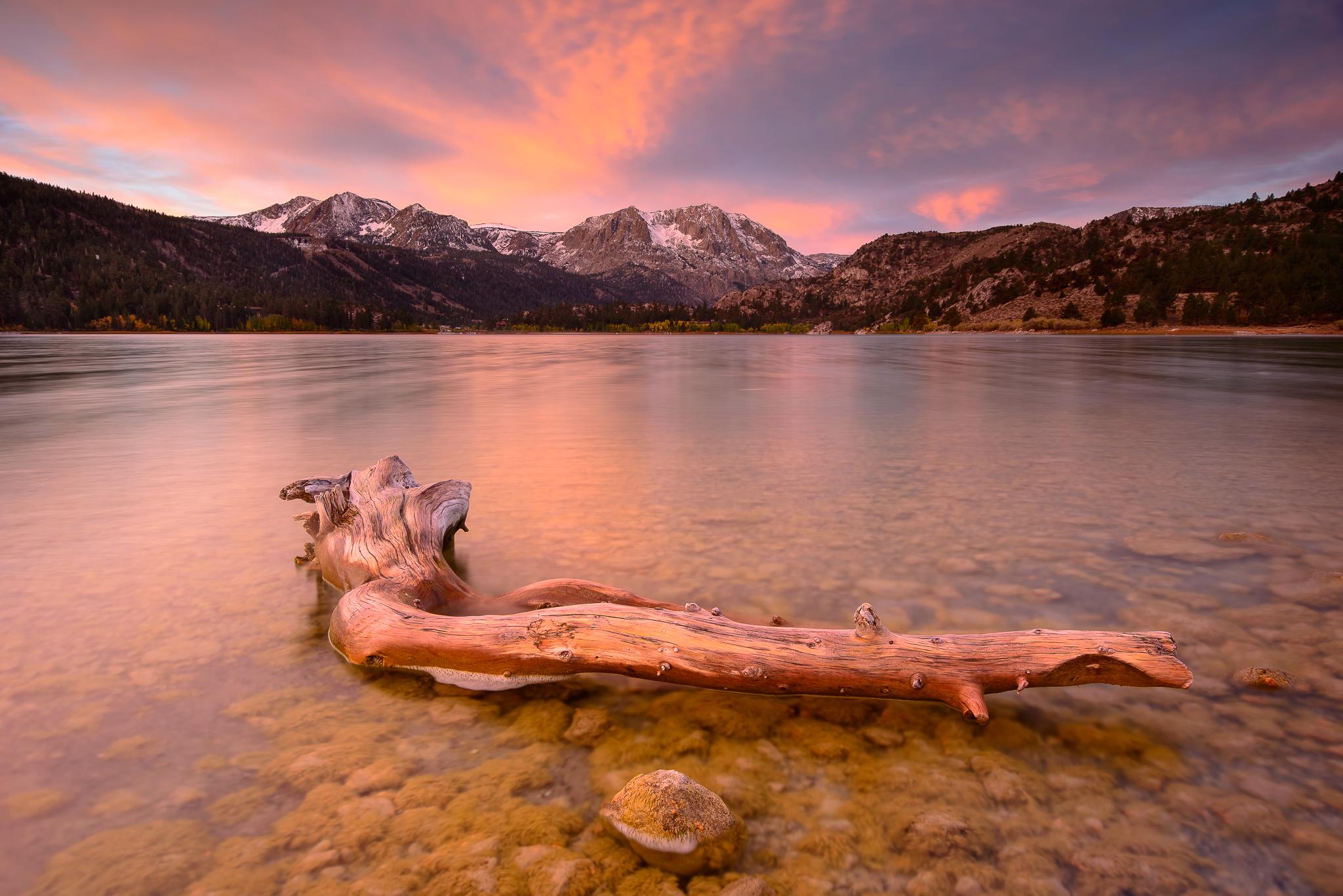 A blazing autumn sunrise over June Lake, CA.