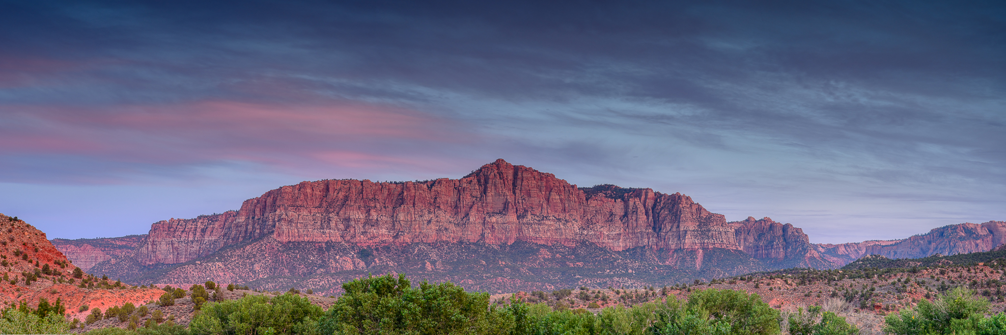 Waning light gives way to a whole spectrum of unseen and brilliant desert colors in Zion National Park, UT.