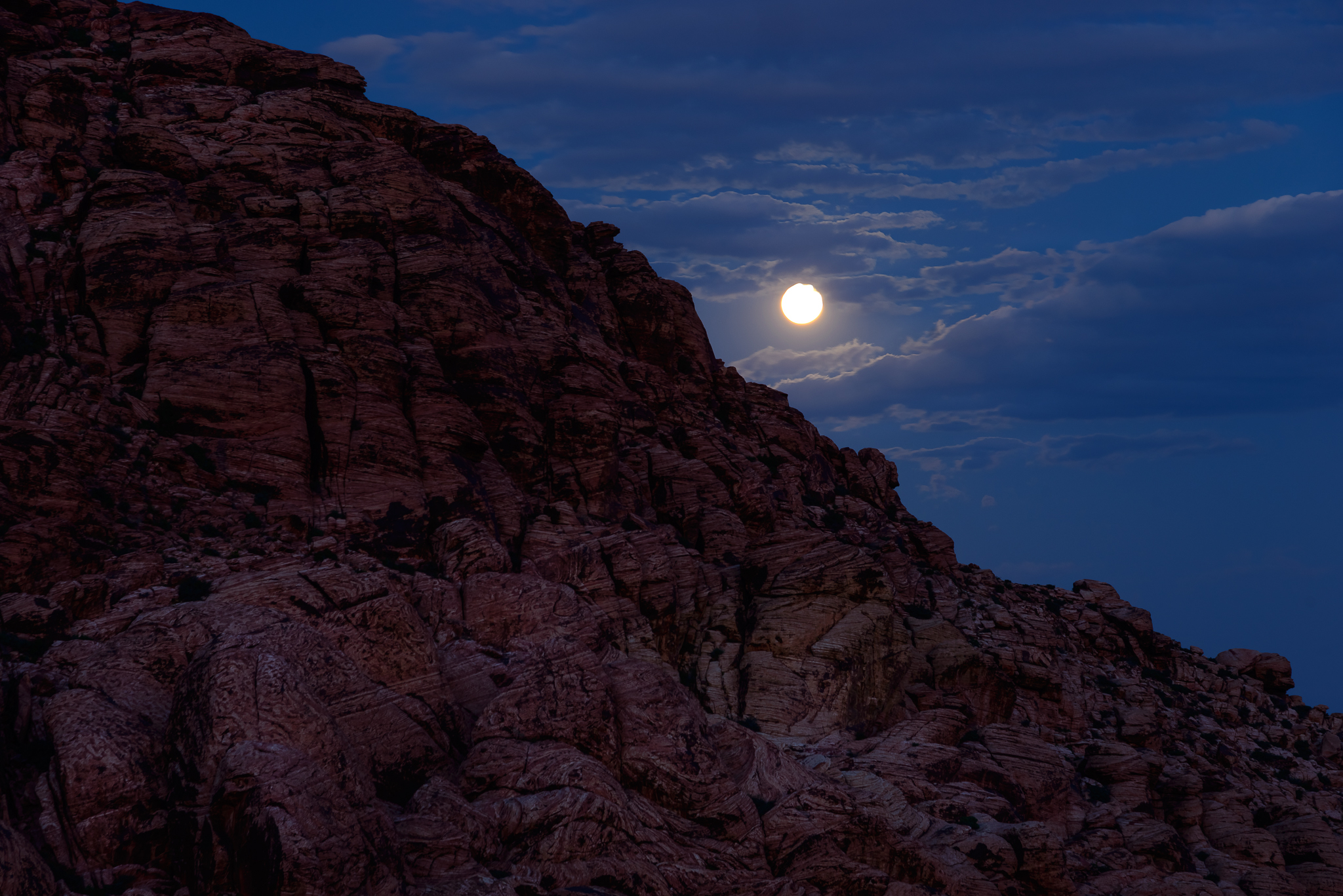 Oh hey moon! A pleasant peak at the full moon rising. Red Rock National Conservation Area, NV.