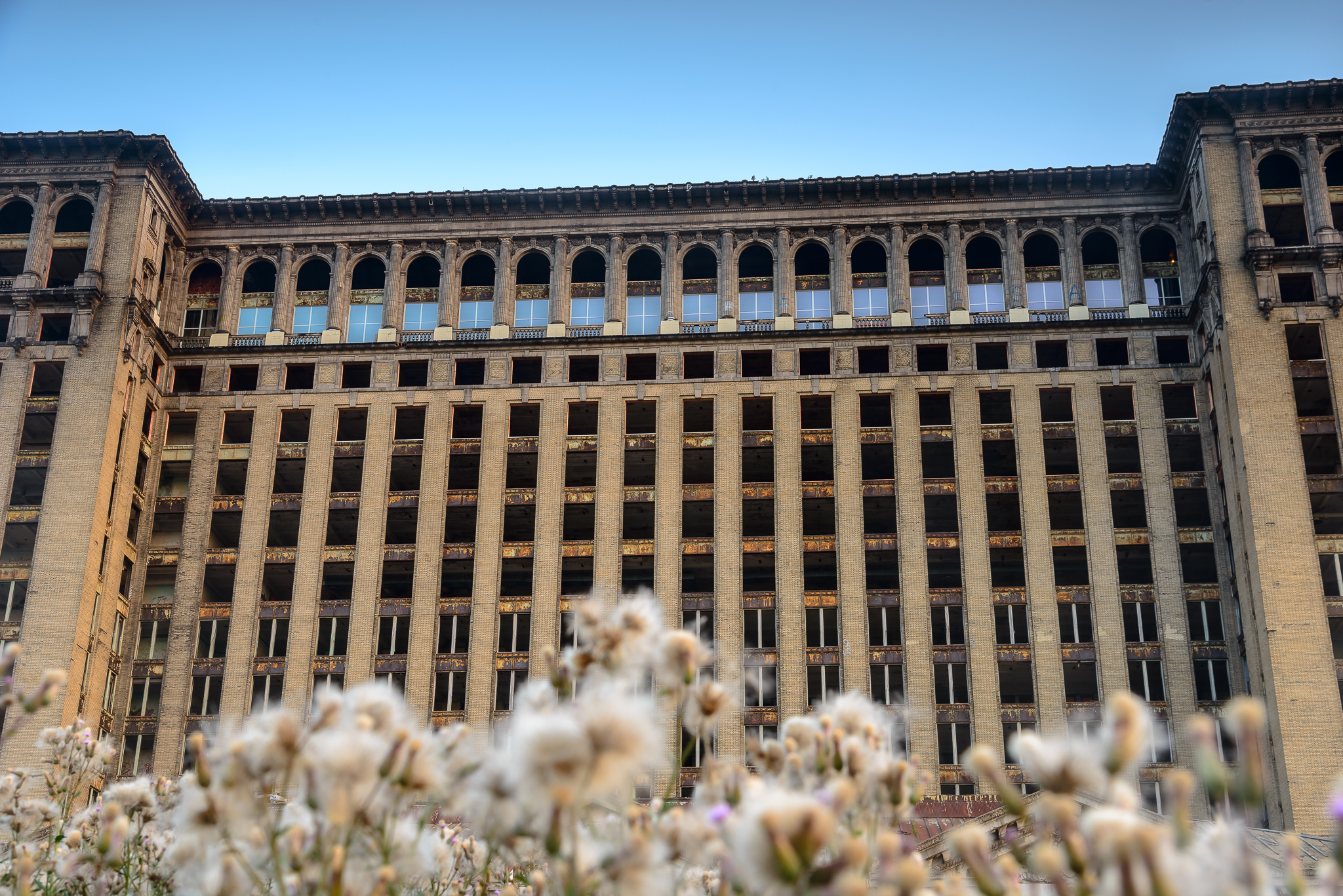 7/3/15. This is honestly a historic image. Abandoned for over 25 years, Detroit's symbol of urban decay Michigan Central Station received it's FIRST FULL SET of windows. The change was real.
