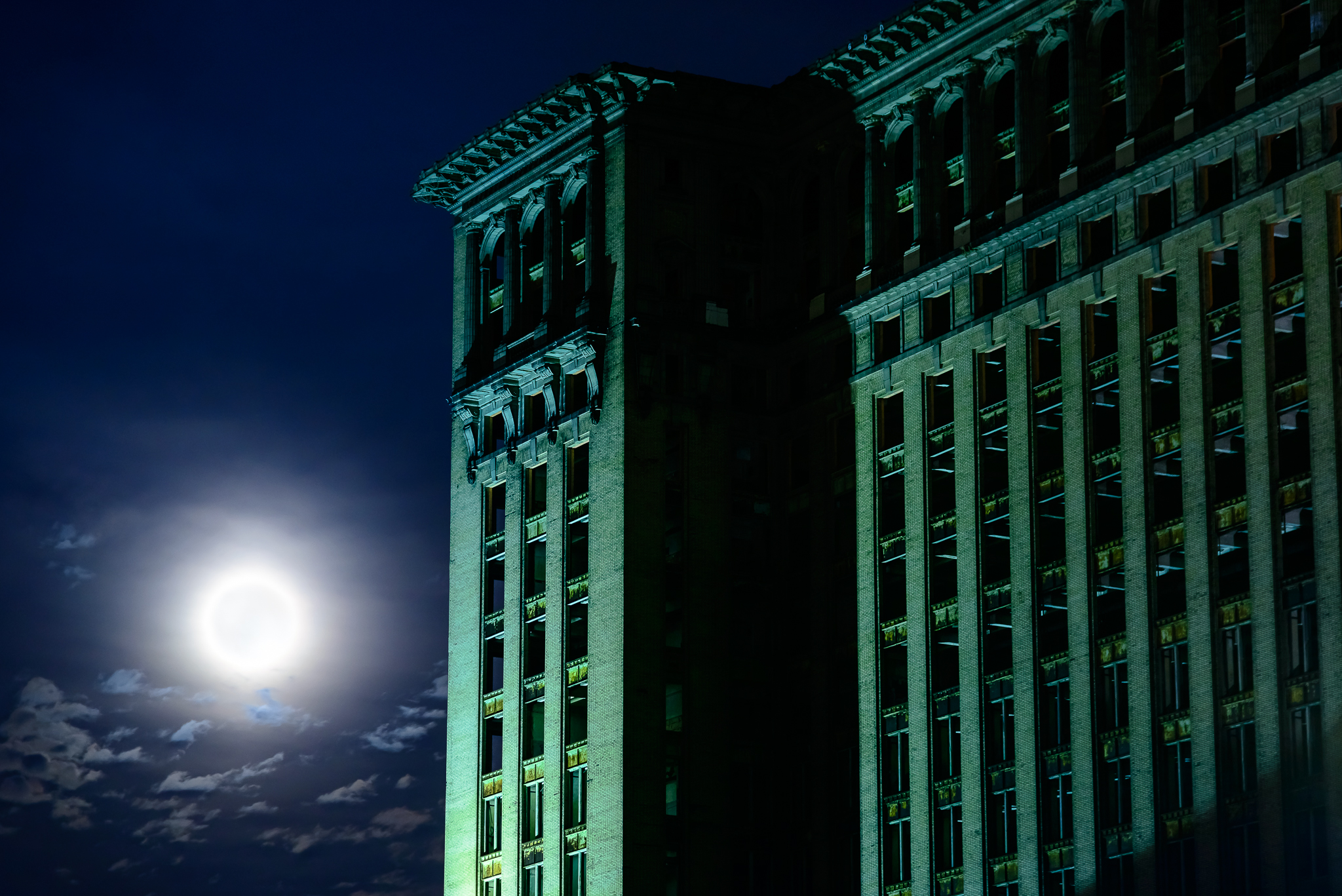 A full moon rises alongside Michigan Central Station, marking it's final stand as an empty shell.