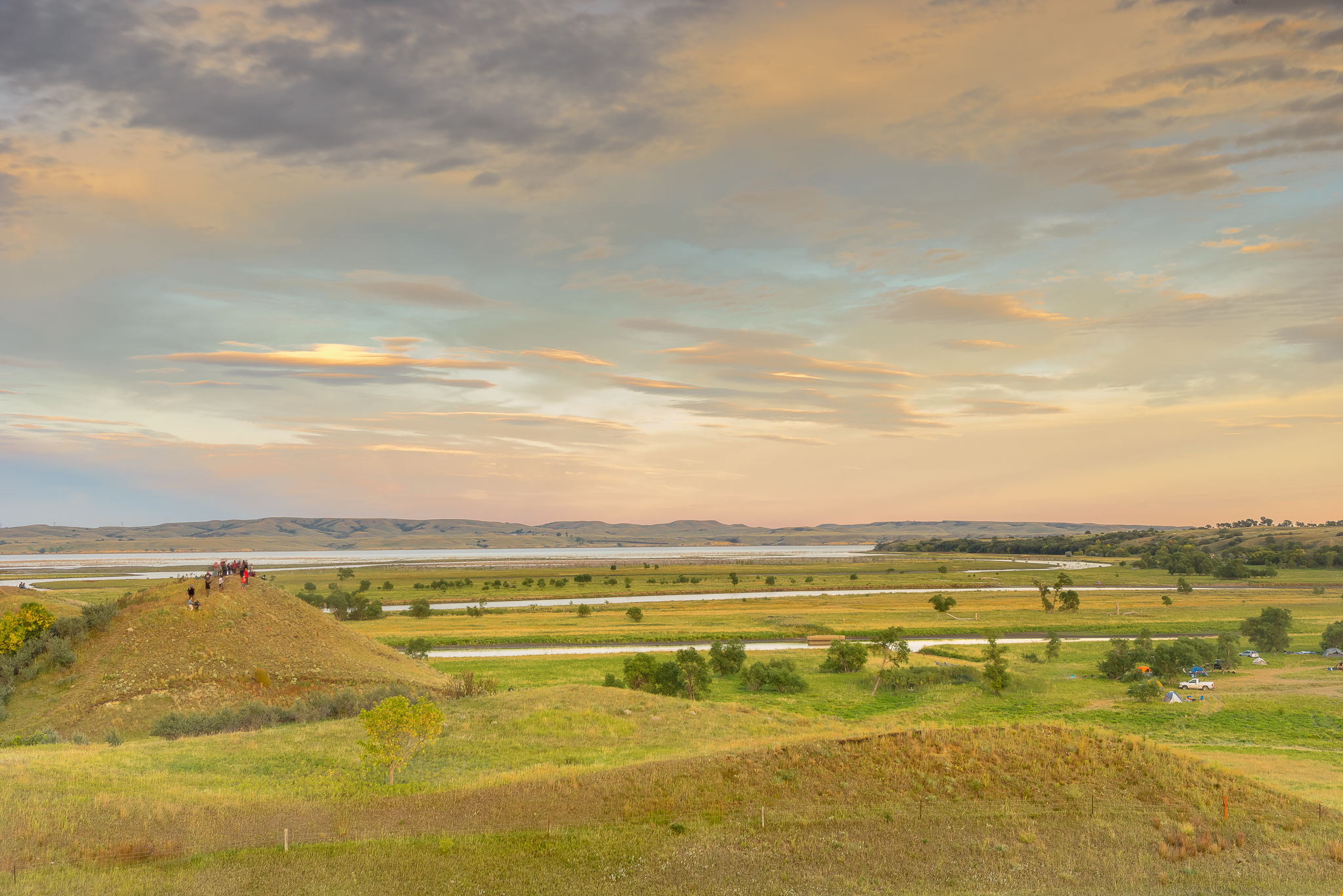 Sunset overlooking Ceremony Hill and the north end of camp.  Cermony Hill was off limits for photographers (non-native at least) so I had to put in some extra work for this perspective.  Standing Rock Reservation Area, ND.