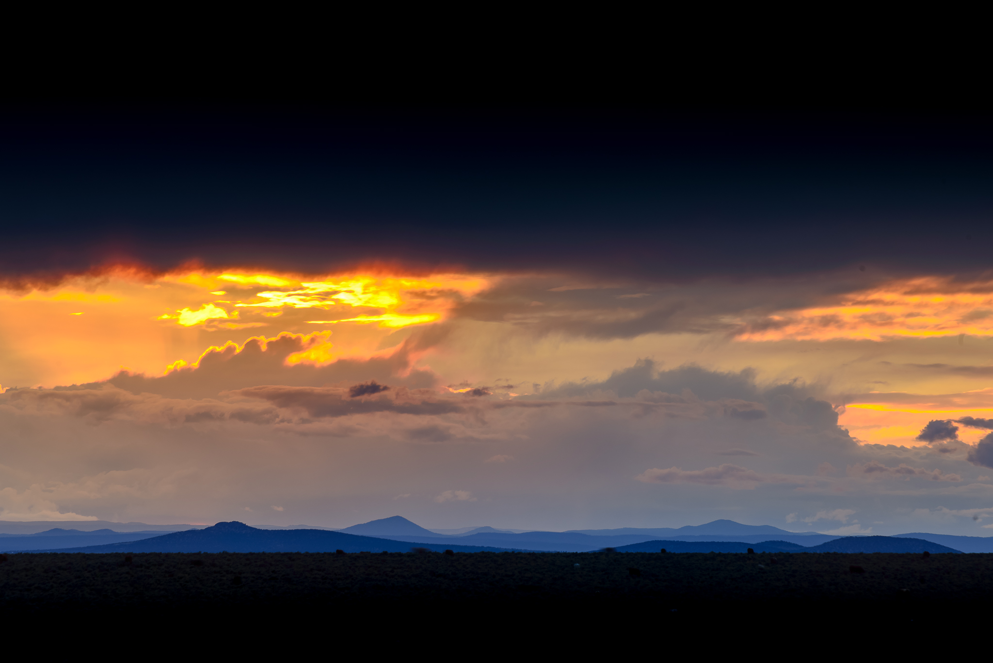 taos_open_field_sunset_black_bars