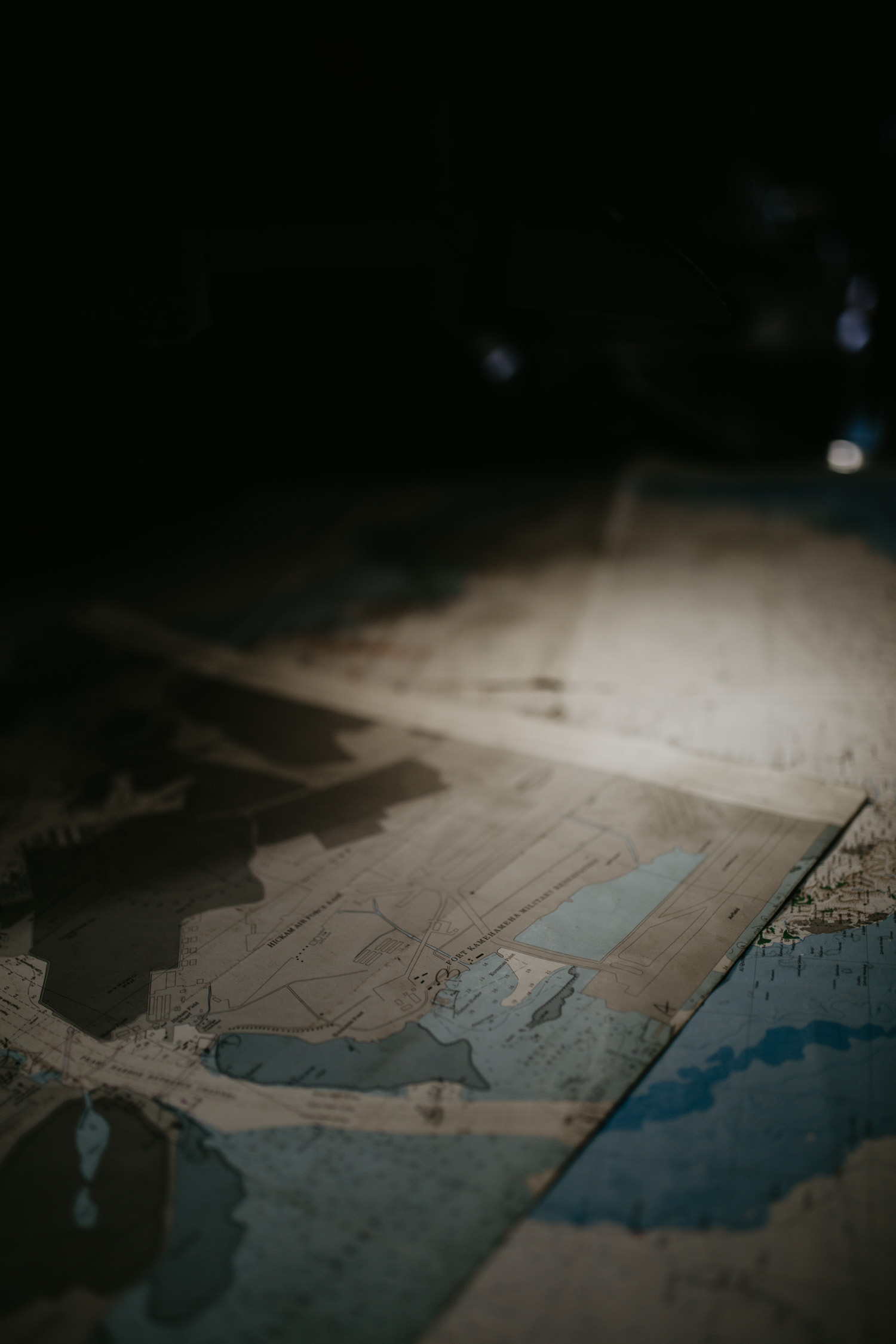 Imagine they are reading through these maps under this dim light…