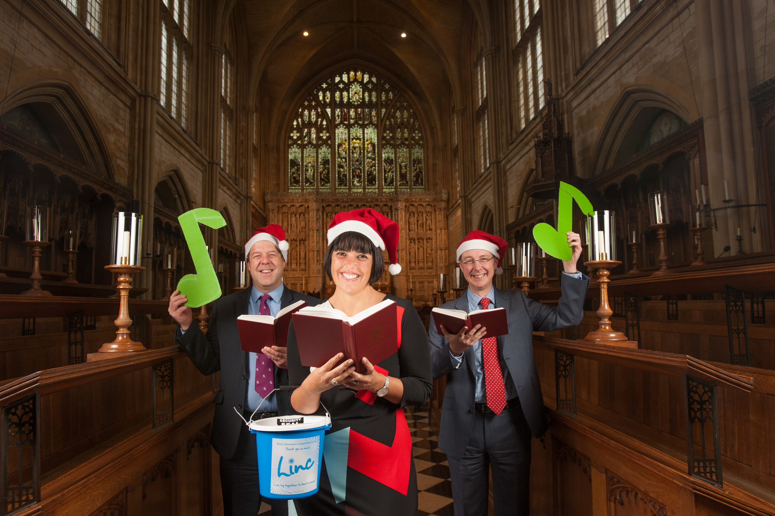 The main lighting was a couple of umbrella flashes either side of the people and a small remote controlled flash hidden in the hymn book to light up the lady in the middle.
