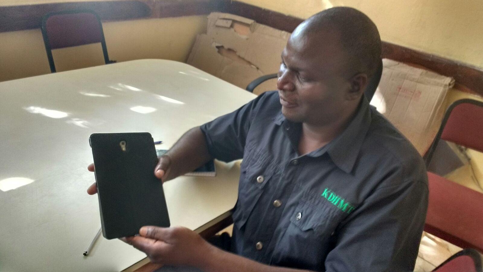 David Chanda Inspecting the new Virtual Doctors Tablets