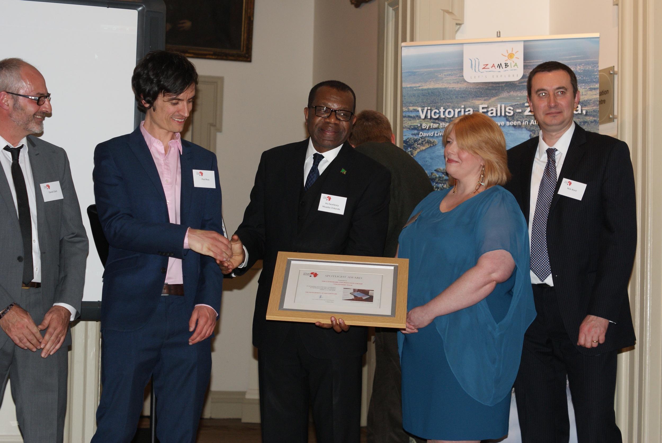His Excellency presents the Spotlight Award to the Landmark team