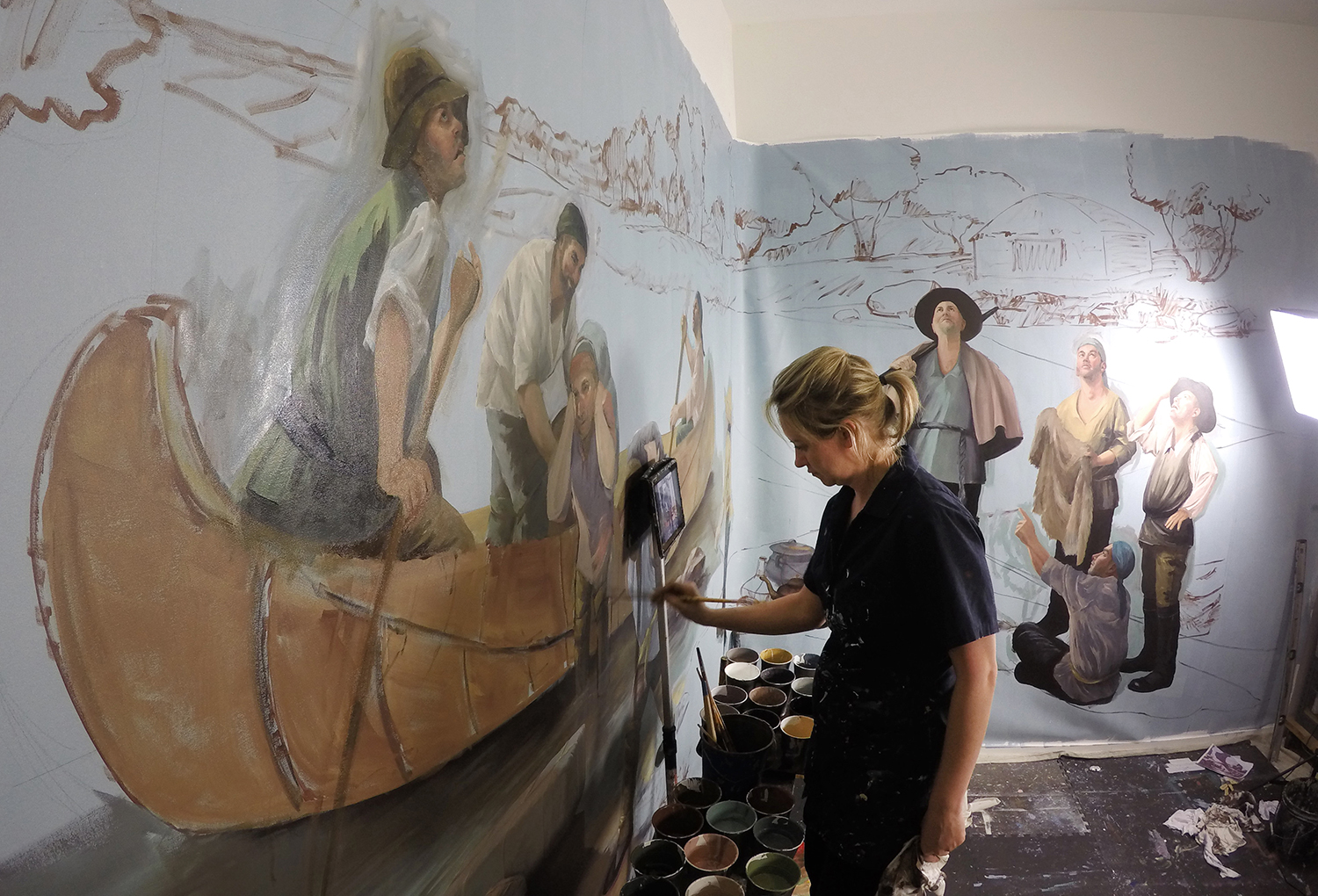 Hattas painted this mural on canvas in her studio. She had the finished piece installed at the Isle a la Cache Museum..