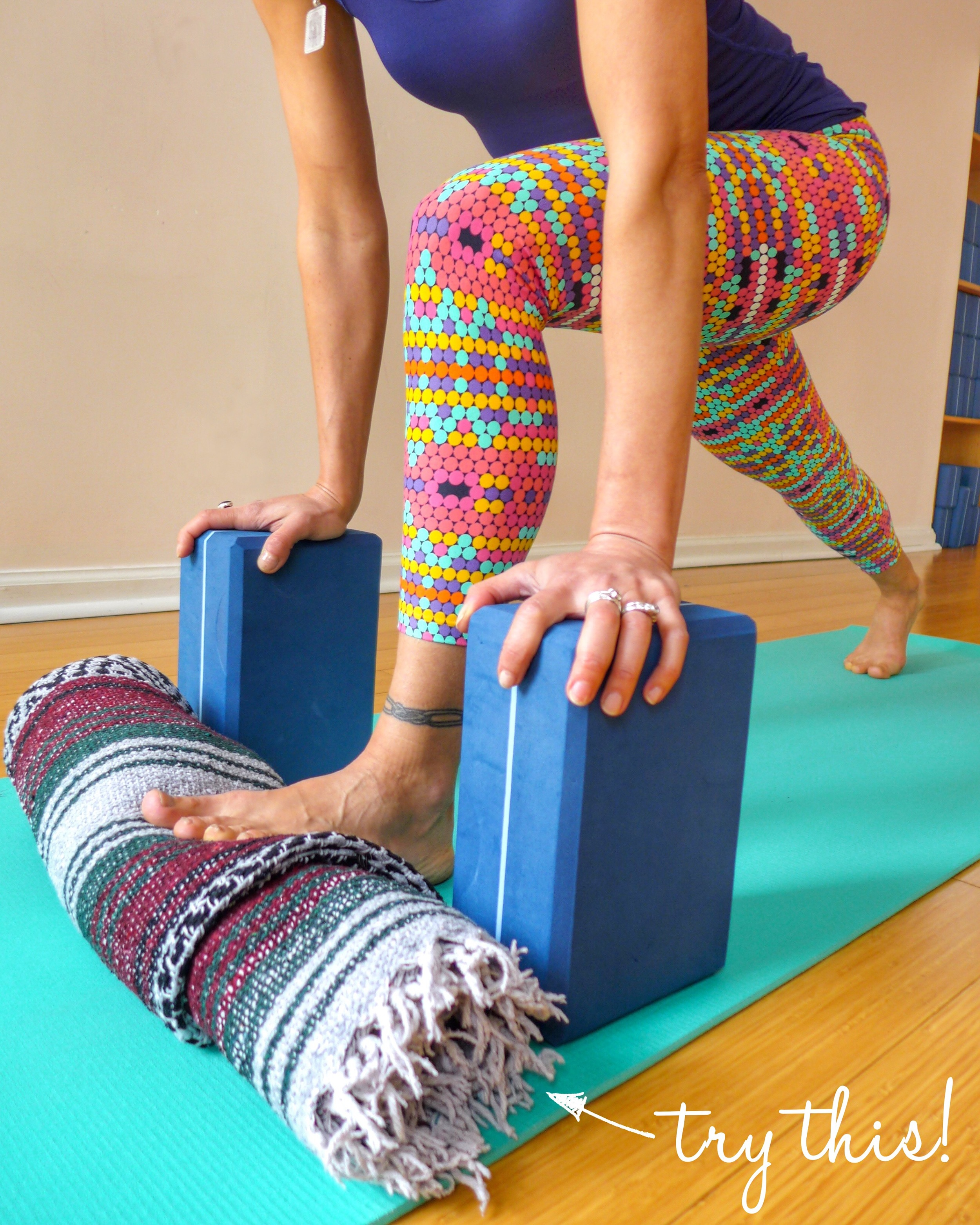 5. LOW LUNGE WITH TOES (OR HEEL) UP A ROLLED BLANKET