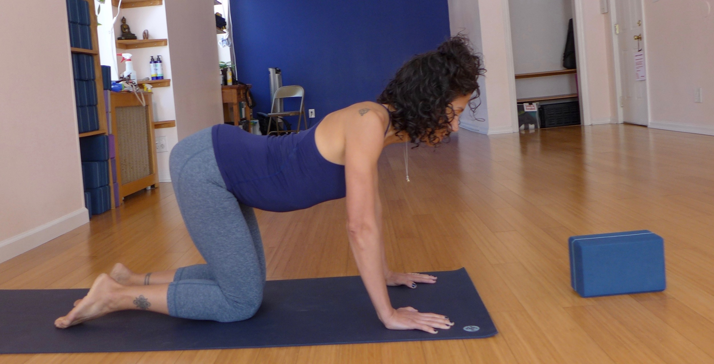"Cow pose: Here's a visual of what happens when we move our spine towards the floor in cow pose, as opposed to the block at the front of the yoga mat. There's too much compression on the lumbar and cervical disks, and our spine has no support from the arms and legs.  Think of your spine as a shoelace you're pulling in opposite directions instead a twisty-tie that you're making into a ""u"" shape."