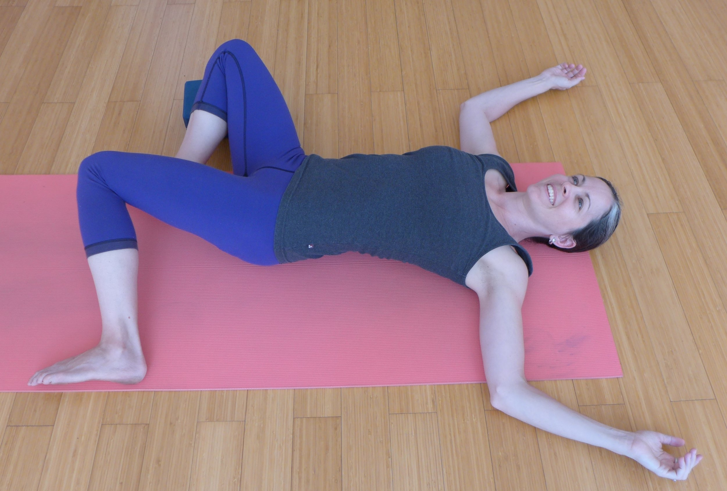 Easy Open Twist: When you set this up, have your feet as wide as the mat. Use a block under the outside leg to support the hip here.