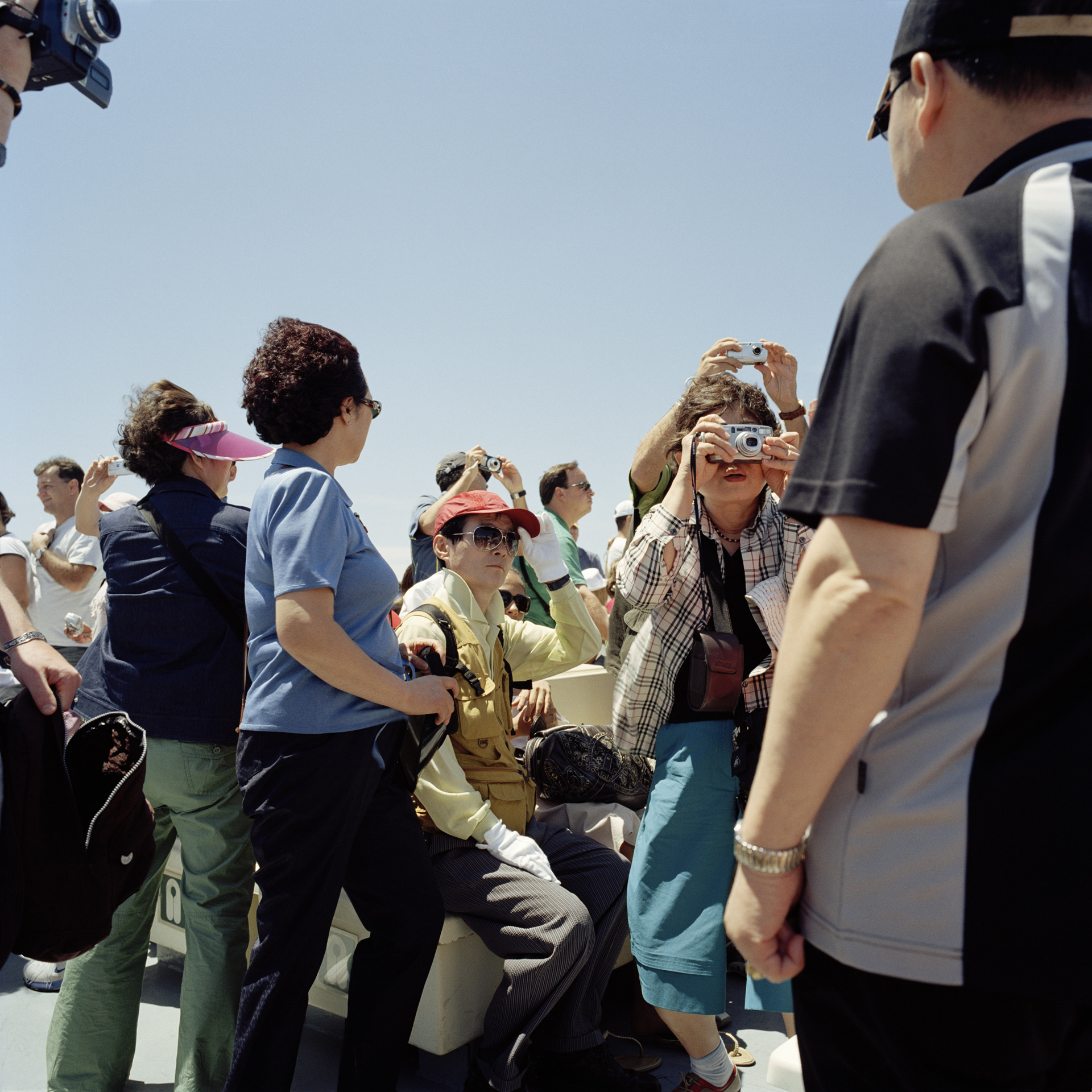 Tourists aboard a ferry headed to the island of Capri.