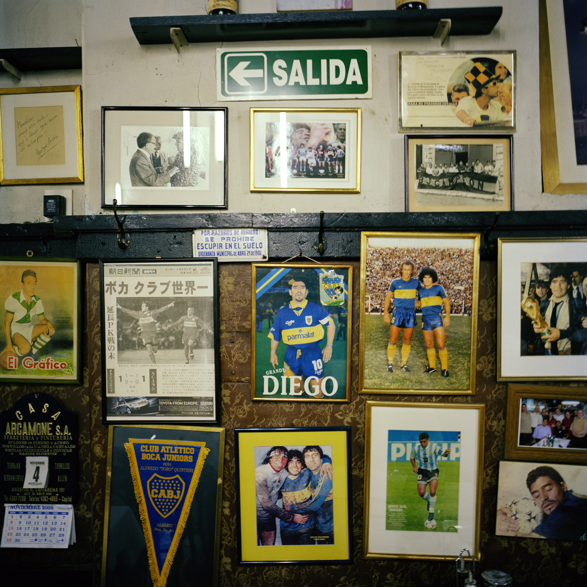 La Boca neighbourhood. El Obrero Restaurant. Walls decorated with Diego Maradona memorabilia.