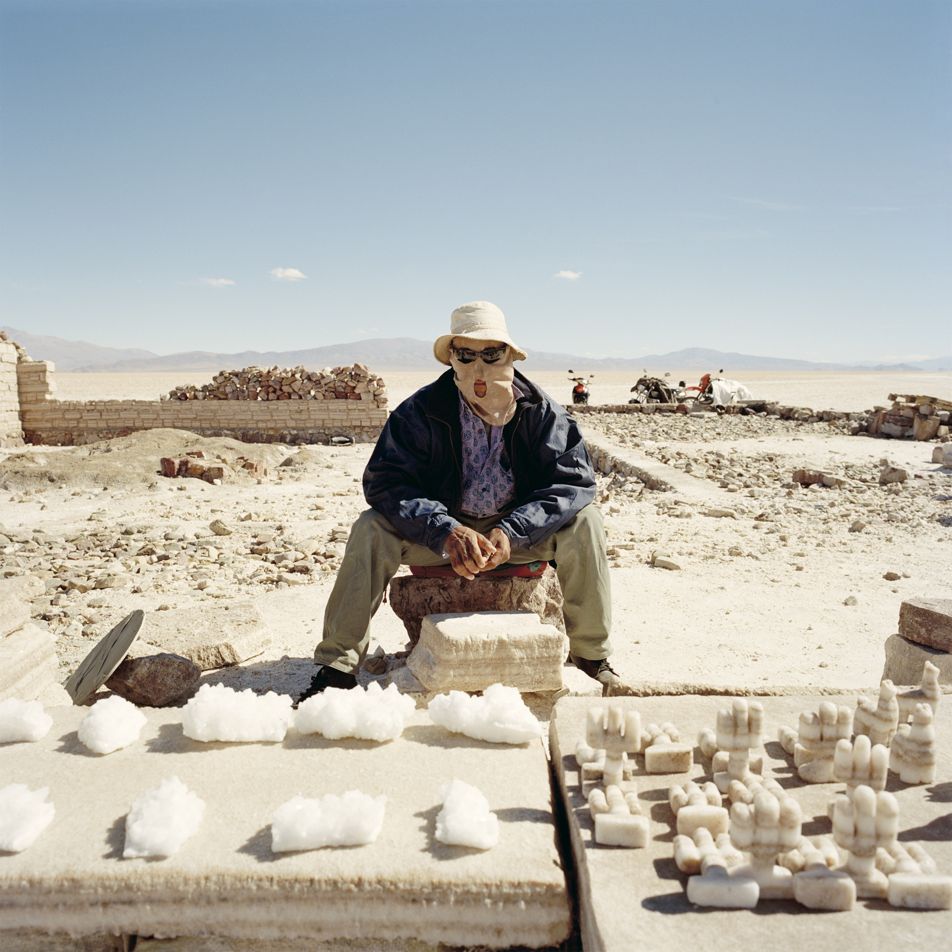 Jujuy Province. Salinas Grande is the biggest salt flat in Argentina, 60 kms in length and covering an area roughly 5200km2, at an altitude of 3350 meters. Salt is harvested from square pools dug into the crystalline salt plain. Souvenir seller.