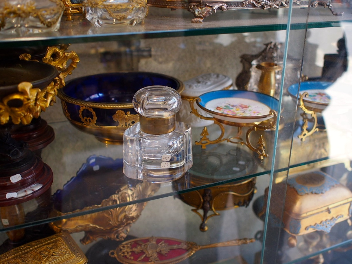 "I had an idea all day that I would circle around and buy this inkwell that I saw first thing in the morning when there was no one at the stall. When I finally tracked down the shopkeeper and inquired, his first word was ""Baccarat."" At 900 euro, mais non. St. Ouen flea markets"