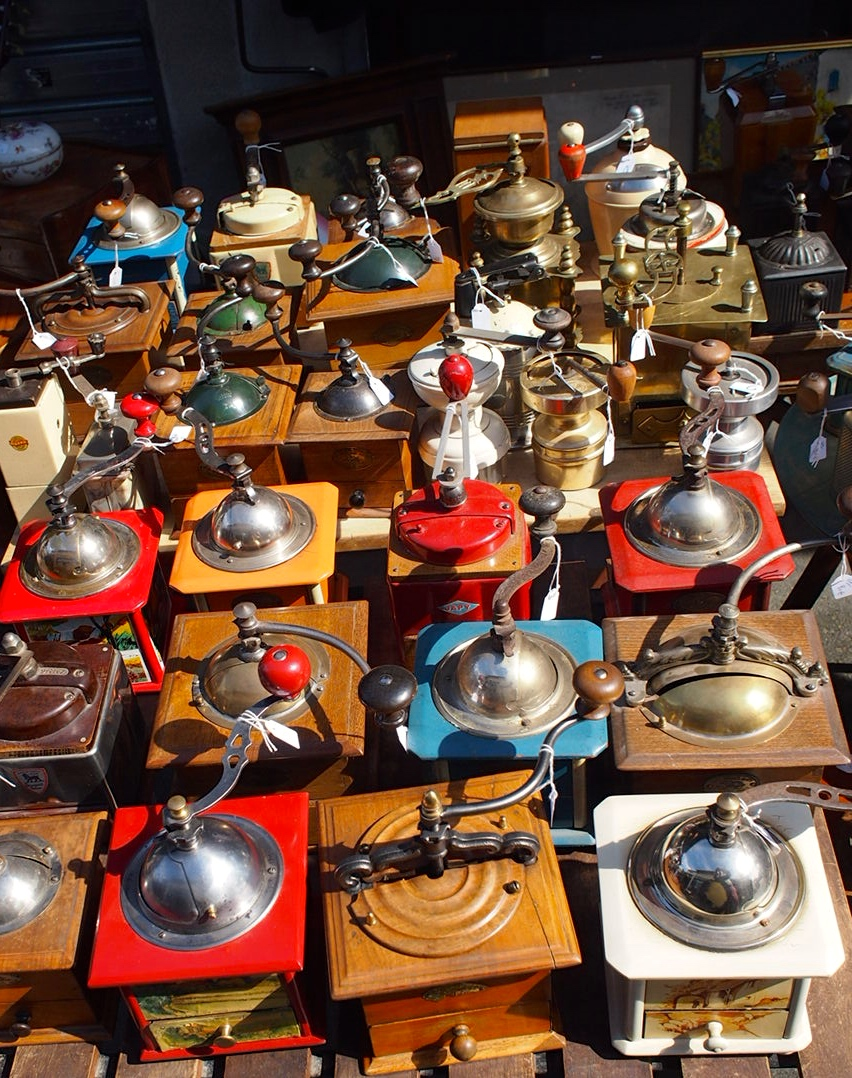 I wanted to buy one of these, Mark did not.  antique coffee grinders, St. Ouen flea markets