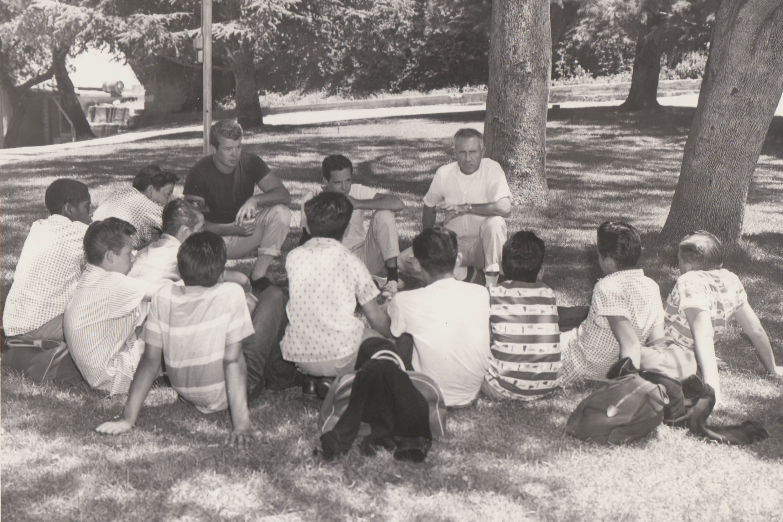 Louis Zamperini leads a group of boys in Bible study and prayer, 1955.