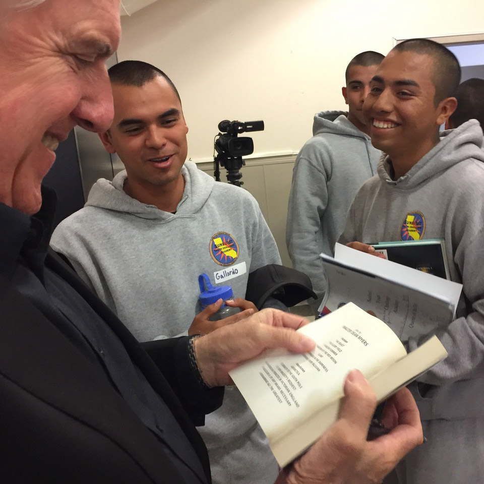 Students at Sunburst Youth Academy are given the opportunity to read  Unbroken , and are very happy to have Luke sign a copy!