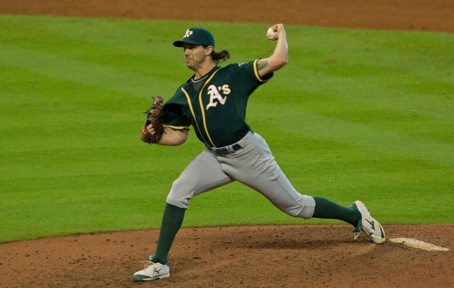 Zeets slinging his patented curveball in his first game back with the A's versus Houston (Photo by Richard Carson)
