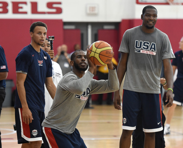 The Baby Faced Assassin and The Durantula discuss the art of the jump shot while playing for Team USA this past summer. (photo by Ethan Miller)