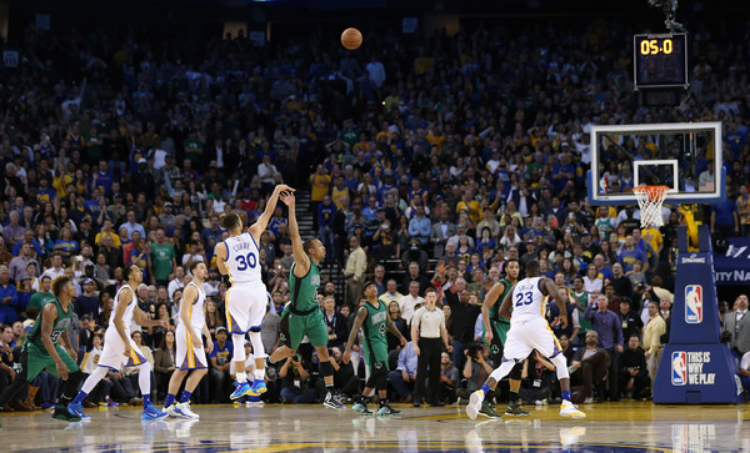 Steph Curry misses a game-tying three pointer in the final seconds of the Warriors' loss to Boston. (photo by Ezra Shaw)