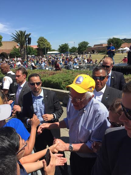 Bernie was at Game 7 to watch the Dubs win the Western Conference title on Sunday. On Friday in Fairfield, Sanders wore his Warriors hat on the campaign trail. (photo by Skaz One)