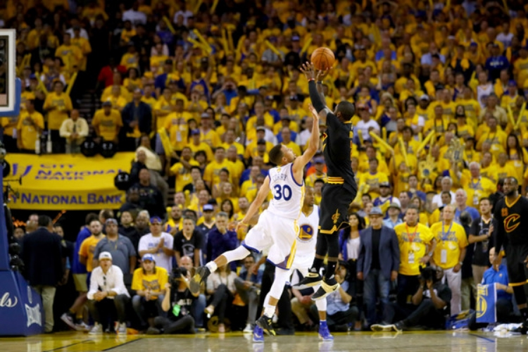 Kyrie Irving hits the game winning three-pointer with 53 seconds left in Game 7 to beat the Warriors 93-89. (photo by Ezra Shaw)