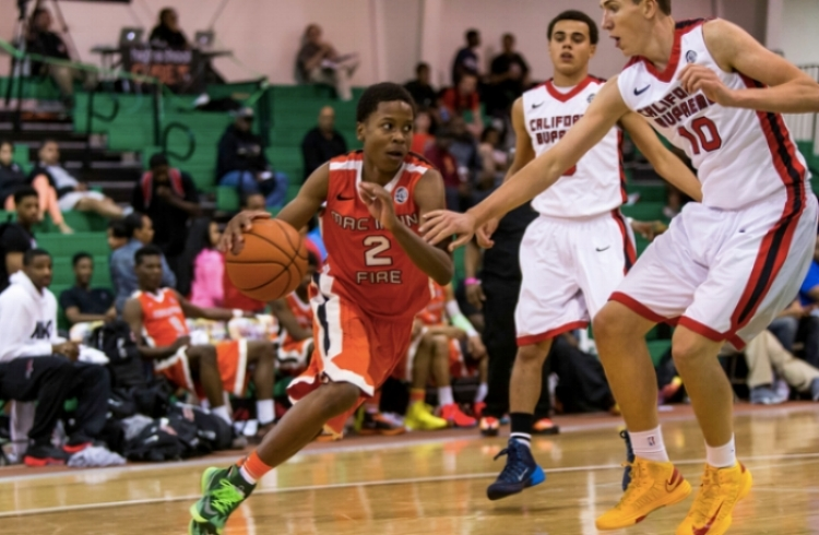 Charlie running the point for the Mac Irvin Fire, one of the top AAU programs in the country. (photo courtesy of MacIrvin.com)