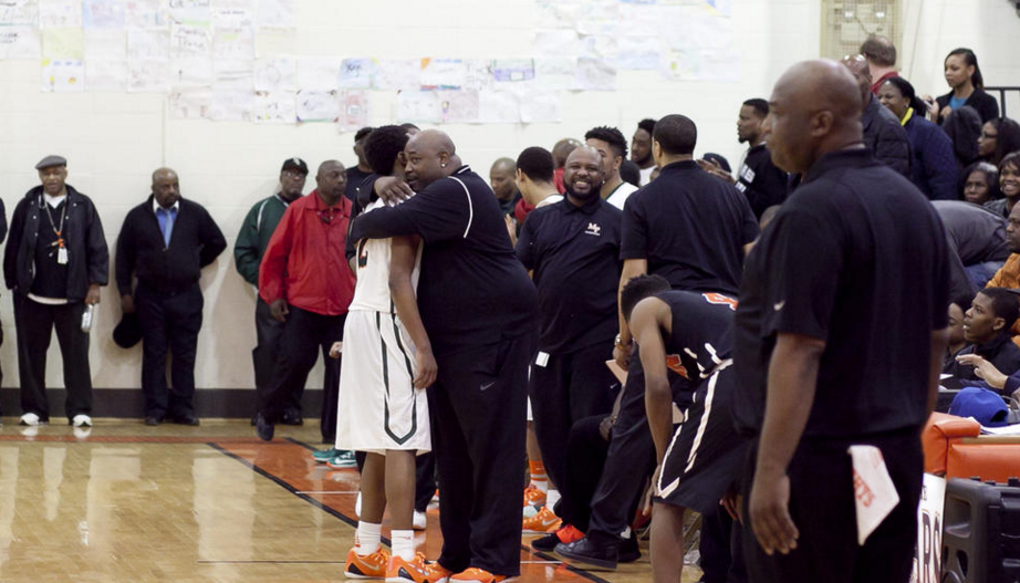 Charlie receives a hug from his high school coach, Nick Irvin. (photo by Eddie Quinones)