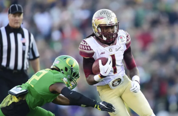 Seisay wraps up FSU's  Ermon Lane  in the Ducks' 2015 Rose Bowl victory. (Photo by Gary Vasquez)