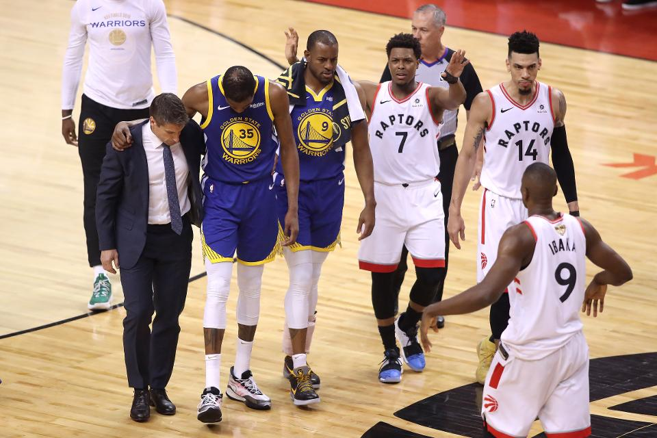 KD's last seconds in a Warriors uniform. The looks on Iggy and Lowery's faces tell you all you need to know. (photo via Getty.com)