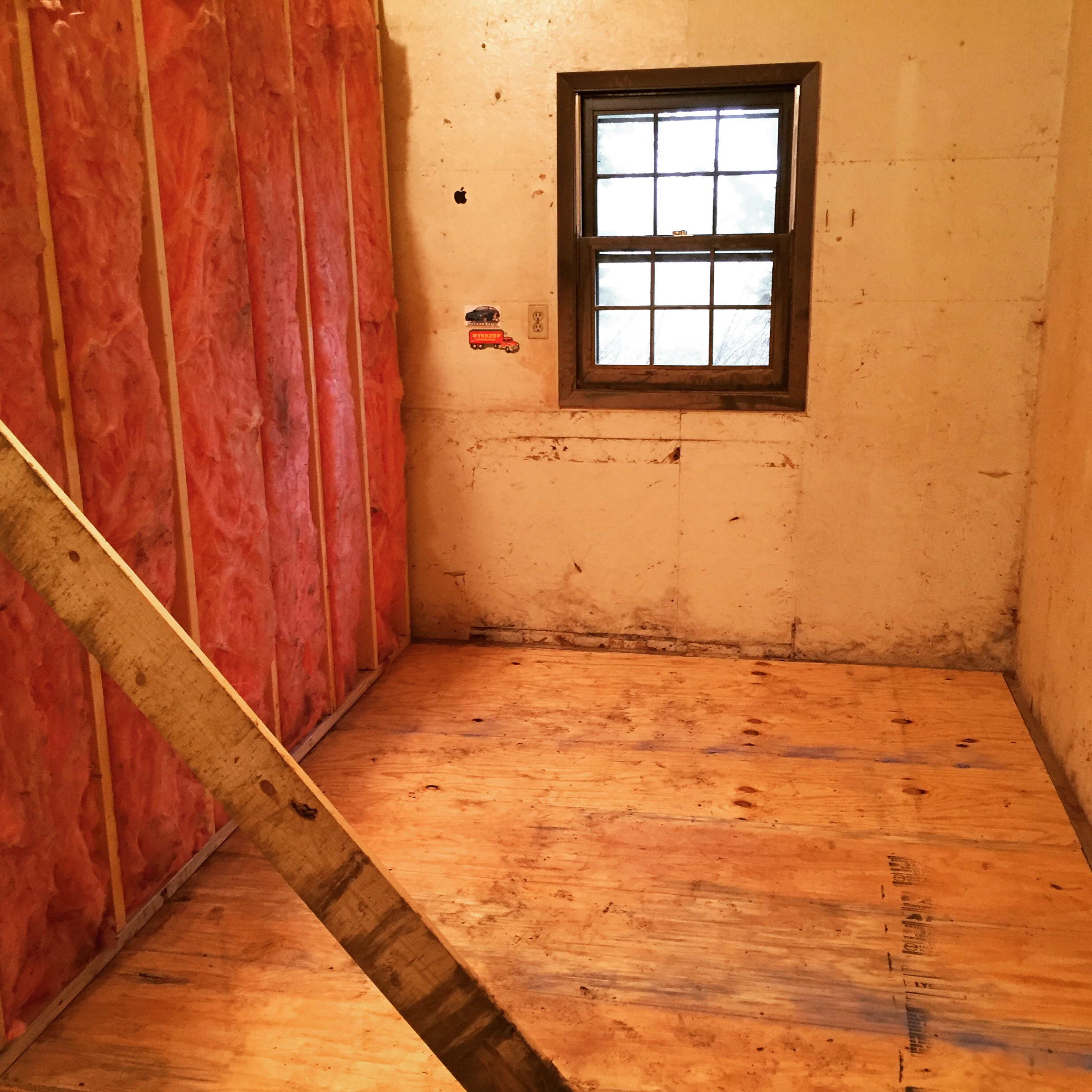 Unfinished walls with a brace to hold them up during test fits.