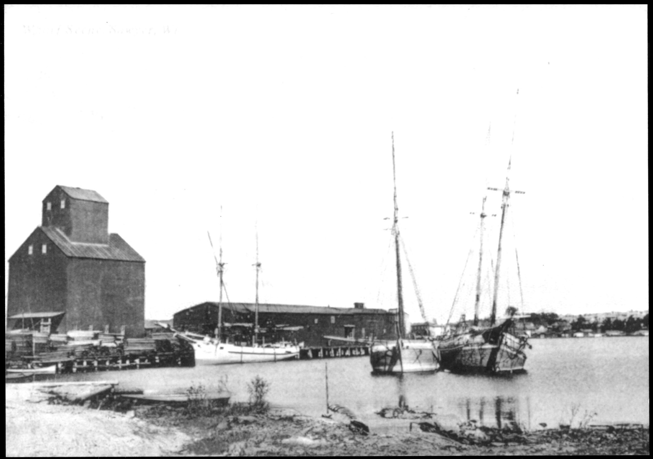 Teweles and Brandeis Grain Elevator and warehouses on the large dock along the working waterfront (Door County Historical Museum)