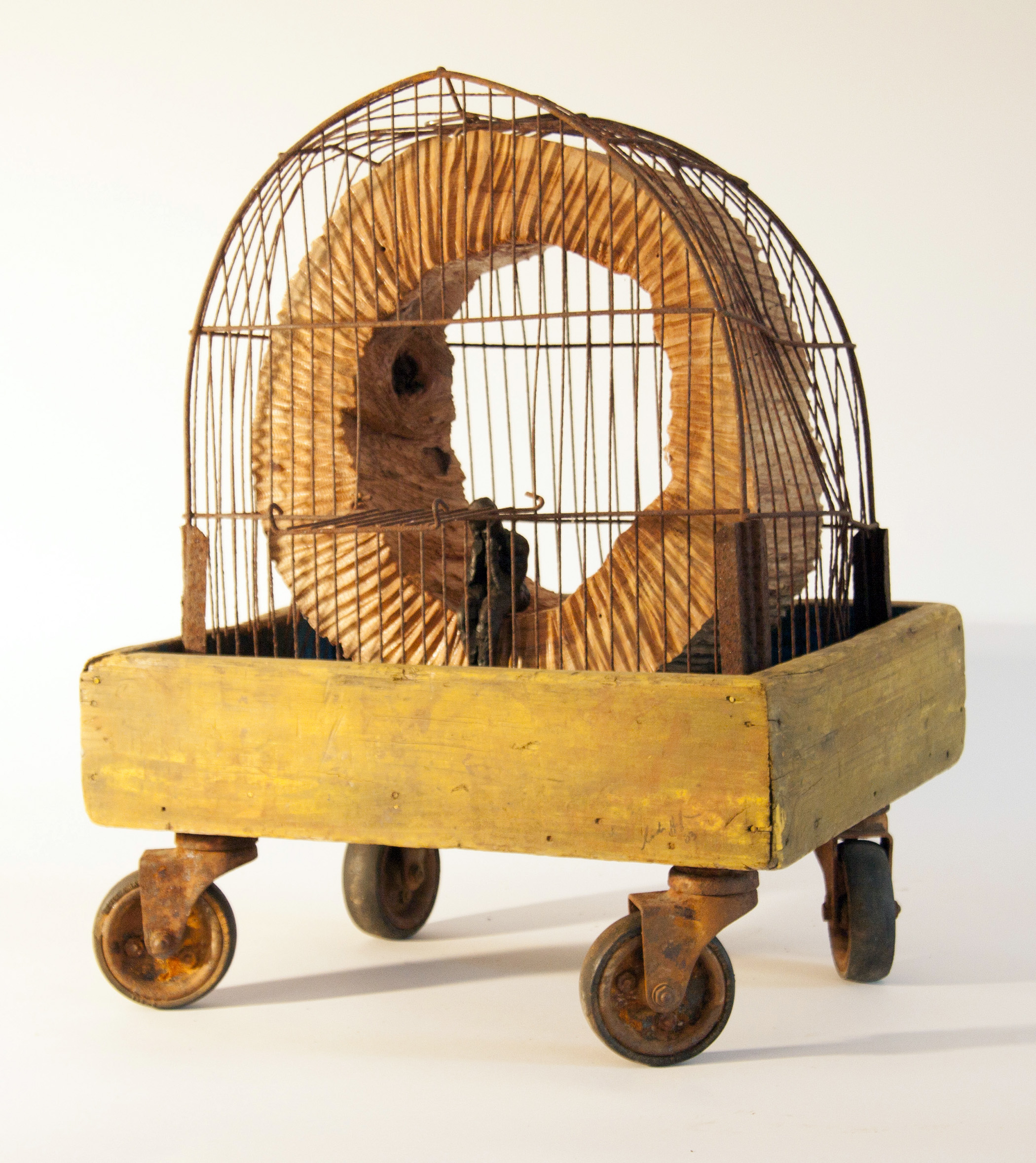 Birdcage , bronze figure, wood, and found objects, LH
